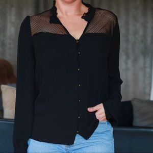 Blouse with statement buttons and sheer paneling